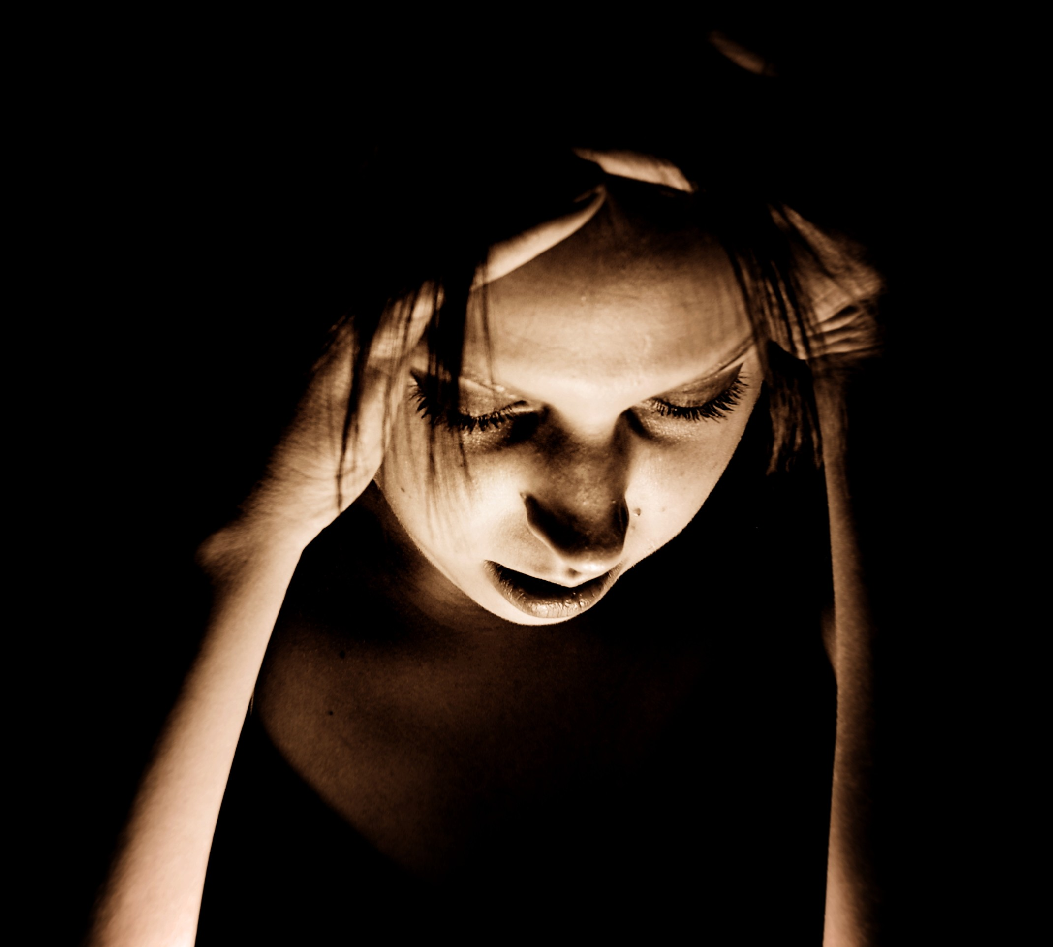 A Girl Suffering from Migraine